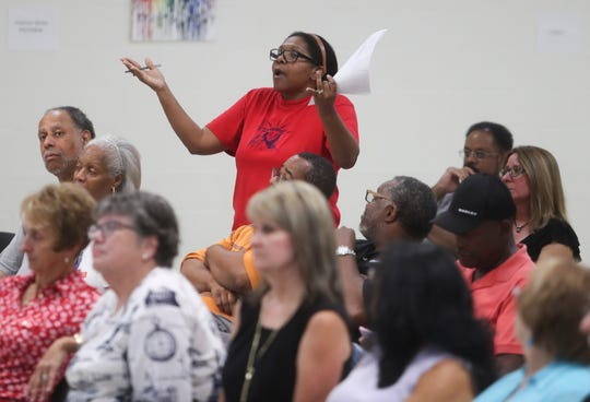A resident voices concern about The Refuge treatment facility in Bear at a public meeting marked by frequent interruptions and contentious exchanges Wednesday.