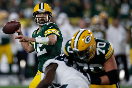 Green Bay Packers quarterback Aaron Rodgers (12) looks to throw a pass against the Philadelphia Eagles during an NFL football game, Thursday, Sept. 26, 2019, in Green Bay, Wis. The Eagles defeated the Packers 34-27. (Jeff Haynes/AP Images for Panini)
