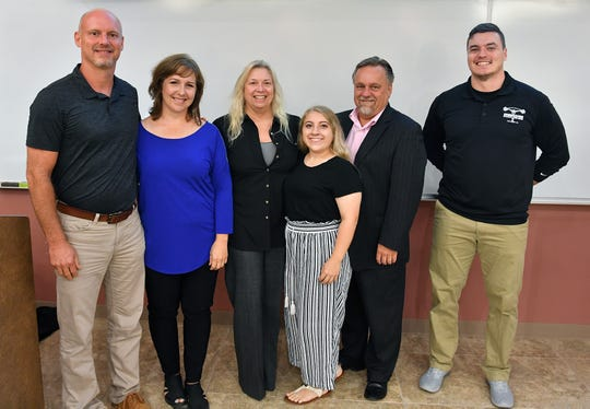 Winners in the 10th anniversary i.d.e.a. WF competition are from left, Barry and Beth Tate with Wichita Valley Pet Cremation, Linda, Gabriele and Scott Poenitzsch of Horseshoe Bend Cellars and Drew Hill with Endunamoo Strength & Conditioning.