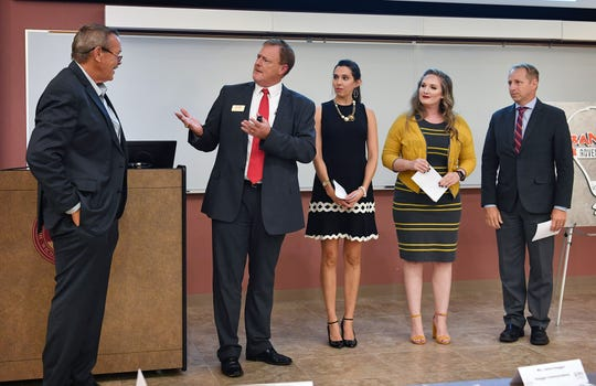 Jeff Watts, left, is introduced by Dr. Scott Manley, along with Merrill Cain, Jessica Edwards and David Toogood as the judges for the i.d.e.a WF 2019 business competition Wednesday at Midwestern State University.