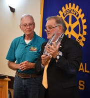 Howard Farrell, right, talks about the crystal award being presented to Roby Christie as the Rotary Club of Wichita Falls Outstanding Citizen of the Year Thursday. Farrell received the same honor in 2017.