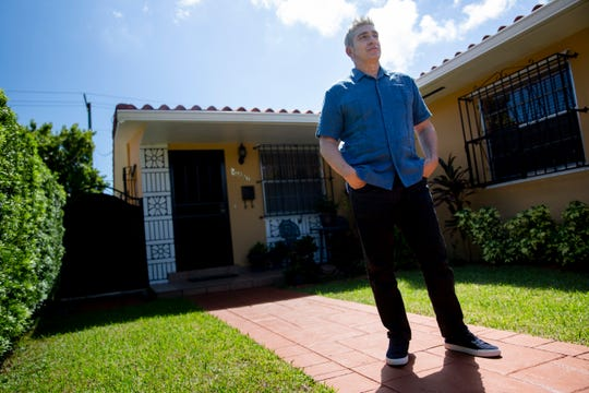 Poet Richard Blanco poses for a portrait at his mother's home in Miami, Florida on Saturday, September 28, 2019.