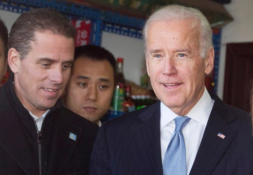 The whistleblower alleges that Trump had demanded Ukrainian investigations into US Presidential candidate Joe Biden and his son Hunter Biden's business involvement in Ukraine. Seen here, then US Vice President Joe Biden tours a Hutong alley with his son Hunter Biden (L) in Beijing, China, on Dec. 5, 2013.