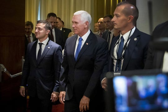 This handout picture taken and released by the Ukrainian presidential press-service on September 1, 2019, shows US Vice-President Mike Pence (C) and Ukrainian President Volodymyr Zelensky (L) walking prior to their talks in Warsaw.