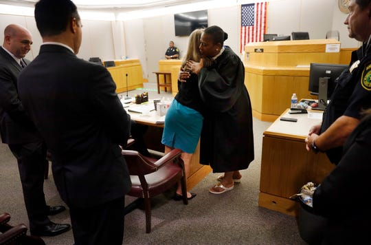 Former Dallas Police Officer Amber Guyger gives State District Judge Tammy Kemp a hug after the judge gave her a Bible and before Guyger left for prison.