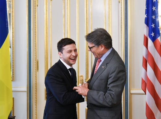 President of Ukraine Volodymyr Zelensky shakes hands with U.S. Secretary of Energy Rick Perry following Zelensky's inauguration ceremony on May 20, 2019 in Kiev, Urkraine. The whistleblower complaint alleges that Trump instructed Pence to cancel his plans to attend Zelensky's May 20 inauguration. Energy Secretary Rick Perry went instead.