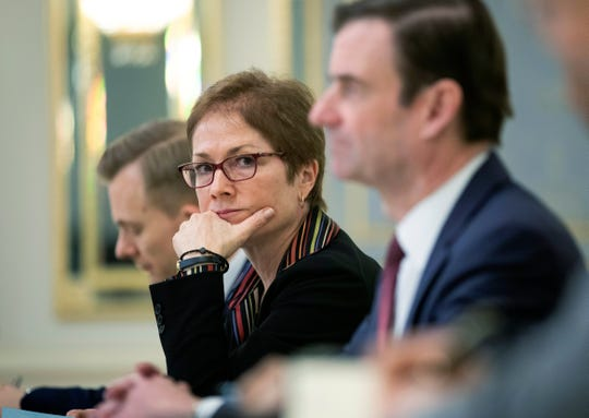 """U.S. Ambassador to Ukraine Marie Yovanovitch was recalled to Washington for """"consultations"""" on April 29, 2019. The whistleblower complaint cited a Rudy Giuliani interview with a Ukrainian journalist published on May 14, 2019 where he stated that Ambassador Yovanovitch was """"removed ... because she was part of the efforts against the President.""""  Seen here, Yovanovitch, center, sits during her meeting with Ukrainian President Petro Poroshenko in Kiev, Ukraine on March 6, 2019."""