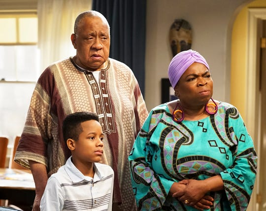 """Travis Wolfe Jr. as Dele, Barry Shabaka Henley as Uncle Tunde and Shola Adewusi as Auntie Olu in """"Bob Hearts Abishola."""""""