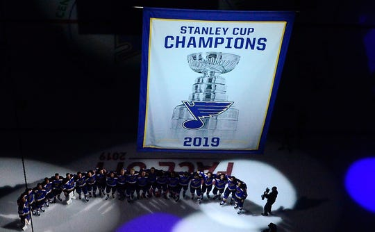 Oct. 2: The St. Louis Blues watch as  their Stanley Cup Champions banner is raised to the rafters before a game against the Washington Capitals.