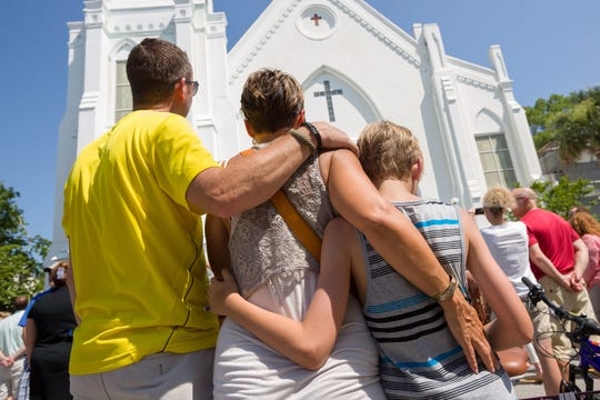 Worshipers gather on June 21, 2015, to honor the victims of a shooting that took place at the Emanuel African Methodist Episcopal Church in Charleston, South Carolina.
