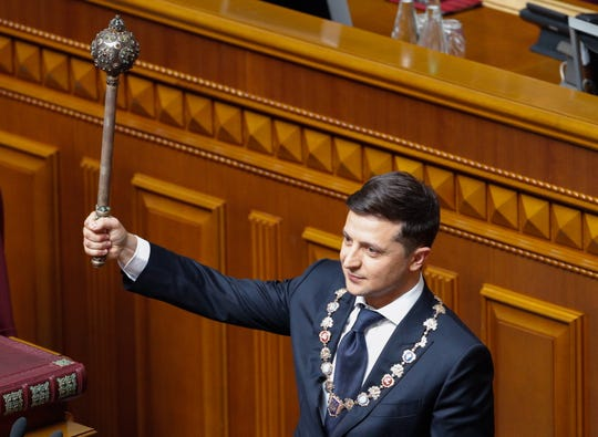 "President-elect Volodymyr Zelensky shows an ancient Bulava (historical symbol of the state power) during his inauguration in the Ukrainian parliament in Kiev, Ukraine,  May 20, 2019.  The whistleblower complaint alleges that during a July 25, 2020 phone call President Trump ""sought to pressure the Ukrainian leader to take actions to help the President's 2020 reelection bid."""