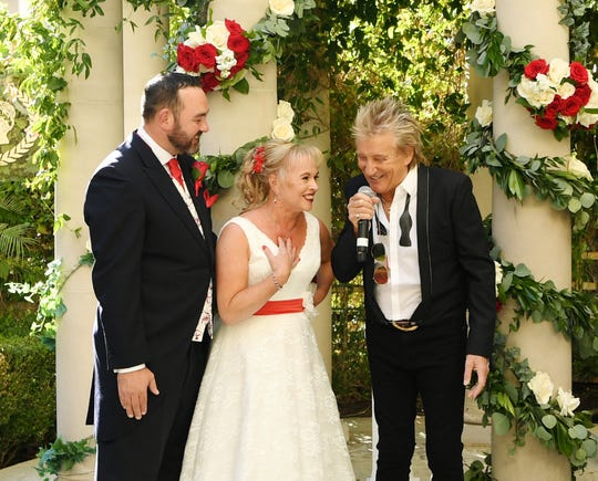 Sir Rod Stewart sings during the wedding of Sharon Cook and Andrew Aitchison from Liverpool, England on October 2, 2019, in Las Vegas.
