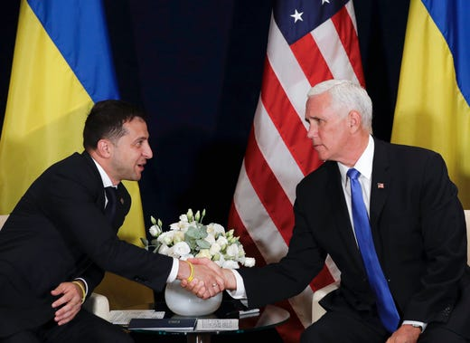 Ukraine's President Volodymyr Zelensky, left, shakes hands with U.S. Vice President Mike Pence, in Warsaw, Poland on Sept. 1, 2019. A Washinton Post article published on Oct. 2, 2019 reported President Donald Trump used Pence in his attempt to pressure the new Ukrainian president to dig up dirt on Joe Biden, but is not conclusive on how much Pence knew about Trump's efforts.