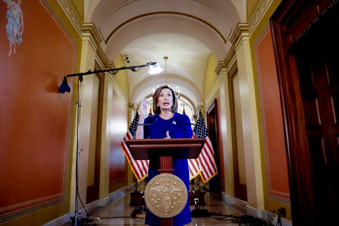 House Speaker Nancy Pelosi of Calif., reads a statement announcing a formal impeachment inquiry into President Donald Trump, on Capitol Hill in Washington, Sept. 24, 2019.