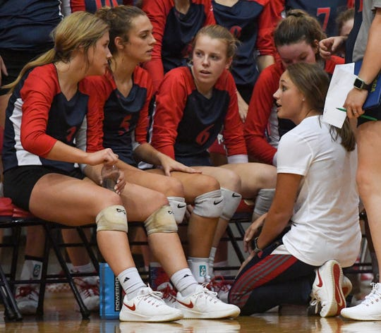 Powdersville coach Brooke Passini, right, shown during an October regular-season match, praised the leadership of the team's five seniors in the Patriots' winning consecutive state titles.