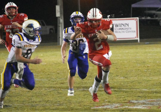 Winnfield's Joshua Tinnerello (2) picks up yards against Buckeye High School Thursday, Oct. 3, 2019. Winnfield won 39-6.