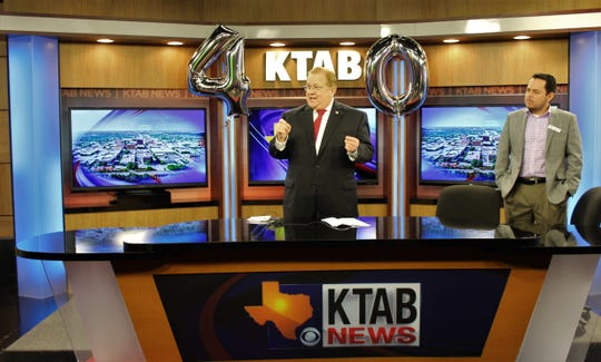 Albert Gutierrez, vice president and station manager for KTAB-TV, right, listens as longtime anchor Bob Bartlett talks about the station's history and highlights during its 40th anniversary event Friday morning.