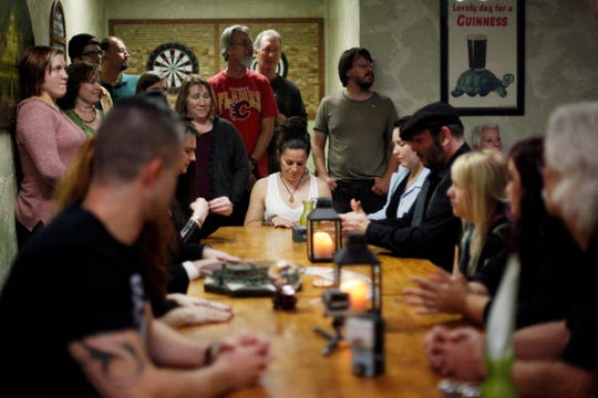 Ghost hunters and intuitives perform a seance at Byrish Haus & Pub on Patton Avenue October 19, 2016.