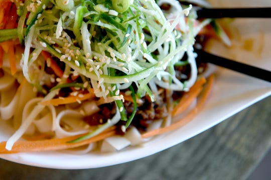 The Typhoon Jing Jing noodle dish at Typhoon Noodle is wide noodles tossed in soybean paste and topped with cucumber, carrot and scallions with minced pork.