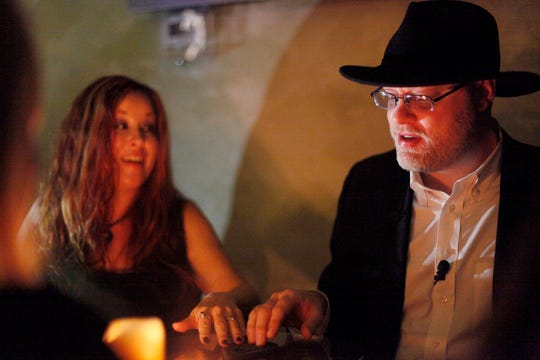 Joshua Warren, a local paranormal expert who founded the Haunted Asheville ghost tour, conducts a seance at Byrish Haus & Pub on Patton Avenue October 19, 2016.