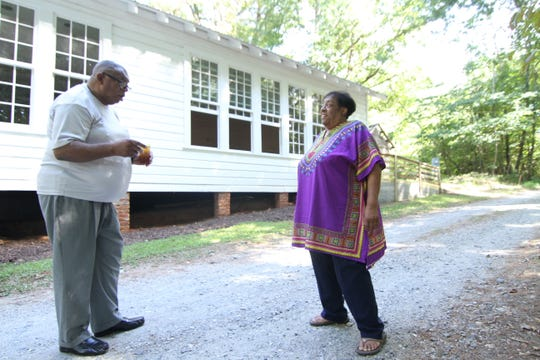 Thelma Briscoe Harrison speaks with her cousin and fellow school alum outside the Mars Hill Anderson Rosenwald School.