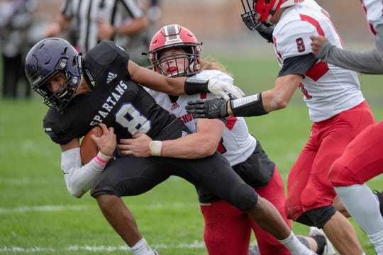 Lakeshore senior Zeke Rohl (44) tackles Lakeview junior Jaden Simonson (8) on Friday, Oct. 4, 2019 at Lakeview High School in Battle Creek, Mich.
