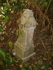 An abandoned headstone in Stratford Cemetery in Scranton.