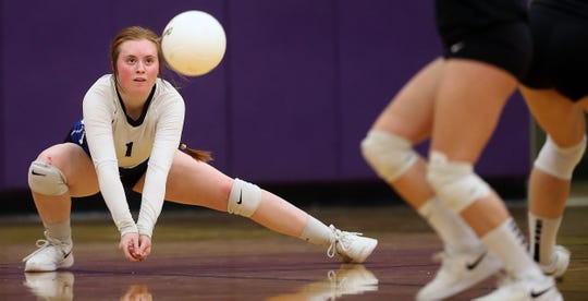 North Mason's Rebekah Fredrickson returns a serve during a volleyball match against North Kitsap on Oct. 3, 2019. The North Kitsap School District is closing the high school gymnasium to investigate ongoing slippery floor conditions.