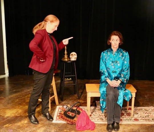 Lotte (Michelle Peterson, left) lectures Lettice (Jennifer Hodges).