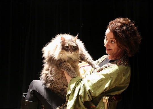 Lettice (Jennifer Hodges) snuggles Felina, Queen of Sorrows (Pushkin).