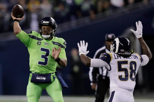 Seattle Seahawks quarterback Russell Wilson passes against the defense of Los Angeles Rams inside linebacker Cory Littleton during the second half against Los Angeles. Wilson's 4 TD passes led to a 30-29 win.