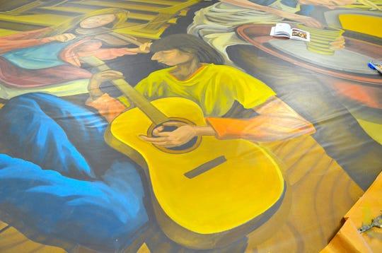 The mural created by Jeremy Russell and Scott Allred for the Black Mountain Center for the Arts, which will go up at the end of October, borrows inspiration from the work of muralist Thomas Hart Benton.