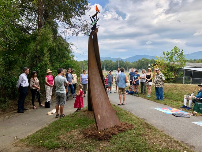 """""""An Exquisite Moment,"""" a sculpture by Julia Burr and Dana Gingras, was dedicated on the north side of Veterans Park on Sept. 28."""