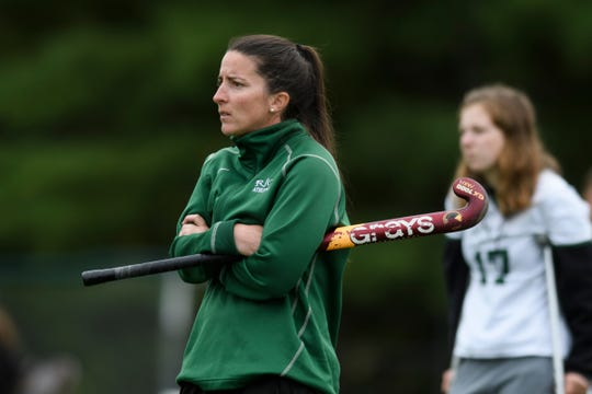 Rice head coach Kelly McClintock watches the action on the field during the high school field hockey game between the Middlebury Tigers and the Rice Green Knights at Rice Memorial High School on Thursday afternoon October 3, 2019 in South Burlington, Vermont.