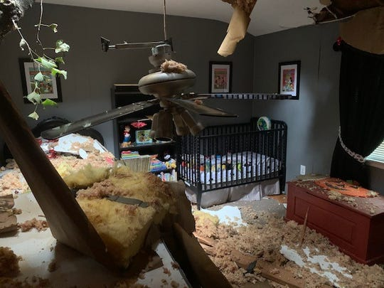 A tree crashed through the nursery of a Cherry Hill home, causing extensive damage but sparing the 1-year-old boy sleeping in the crib at the time.