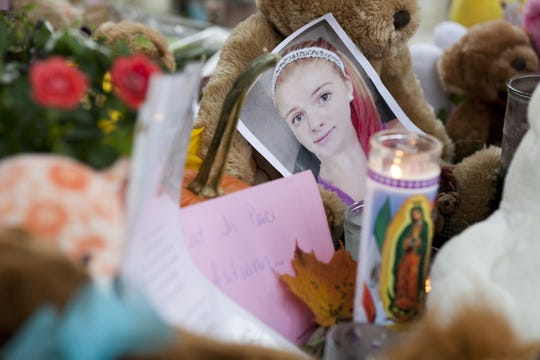 Mourners grieve at a growing memorial for 12-year-old murder victim Autumn Pasquale, Thursday, Oct,. 25, 2012 in Clayton.
