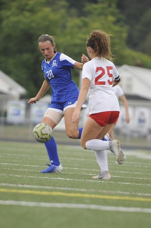 Chillicothe's Avery Erslan receives a pass during an 8-1 win over Jackson on Thursday, Oct. 3, 2019 at the Obadiah Harris Family Athletic Complex in Chillicothe, Ohio.
