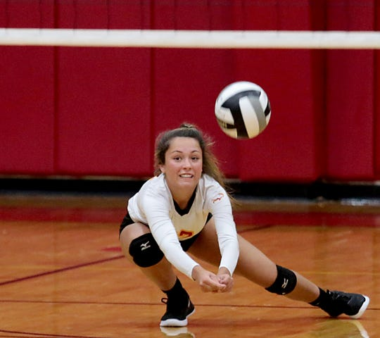 Fenwick libero Isabella DeSalvo digs out a Kettering Alter serve during their volleyball game at Fenwick in Middletown Thursday, Oct. 3, 2019. Fenwick won, 3-0.