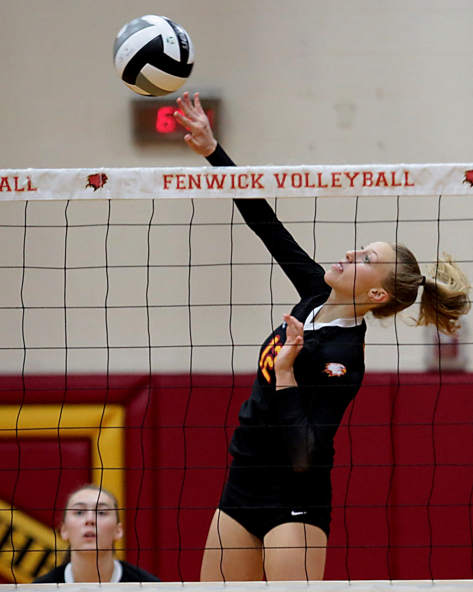 Kate Hafer, from Bishop Fenwick, returns a volley to Kettering Alter during their volleyball game at Fenwick in Middletown Thursday, Oct. 3, 2019. Fenwick won, 3-0.