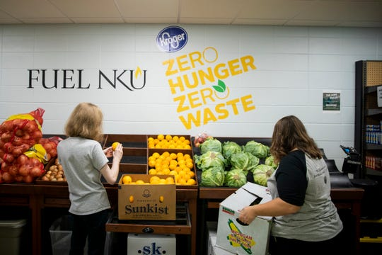 Valentine Peterson and Keyah Are restock produce at Fuel NKU, a food pantry at Northern Kentucky University Monday, September 30, 2019 in Highland Heights, Kentucky.