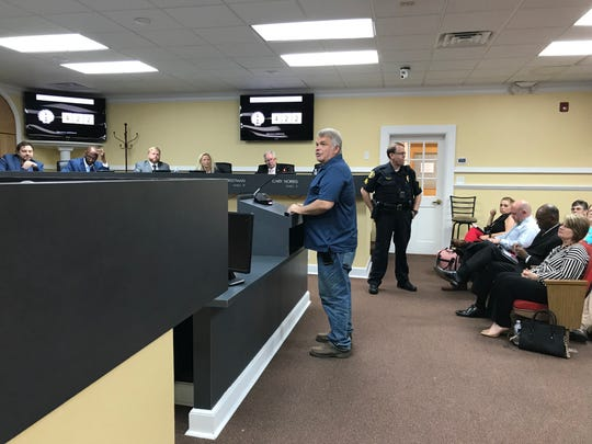 Bill Belew addresses the Clarksville City Council on Thursday, Oct. 4, about his request to rezone an area near Exit 11 for apartments
