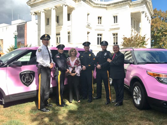 It was announced during a press release in Somerville on Thursday that three police cars were wrapped in pink to raise awareness of Breast Cancer Awareness Month. The cars will be on display at the Far Hills Race Meeting.