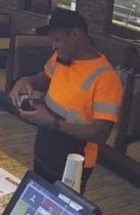Police are looking to identify this man in connection with allegedly passing counterfeit money.