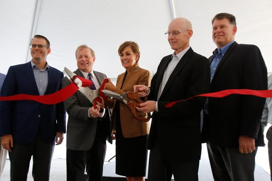 Iowa Gov. Kim Reynolds flanked by Norwalk Mayor Tom Phillips and Michael Foods president Mark Westphal cut the ribbon on a new plant in Norwalk. Michael Foods celebrated the opening of a new plant in Norwalk on Oct. 3.
