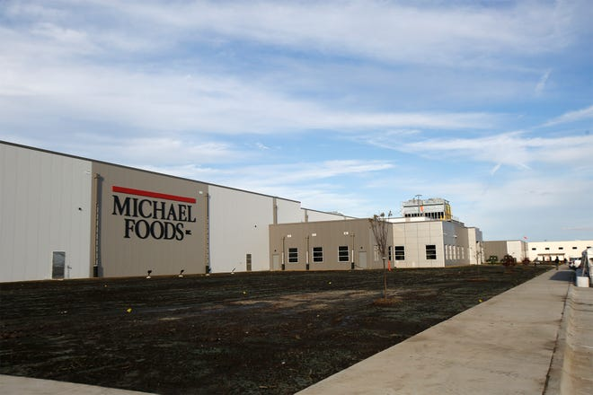 Michael Foods celebrated the opening of a new plant in Norwalk on Oct. 3.
