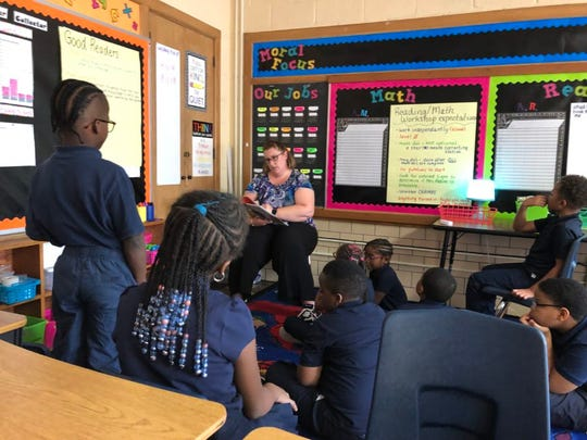 "Students in a classroom for advanced readers at Detroit Premier Academy listened to a teacher read a story that contained words like ""thesaurus."""