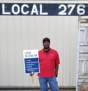 Mike Cartwright in front of UAW Local 276 hall in Arlington, Texas. Cartwright also went on strike in 2007 against GM and feels stronger community support this time.