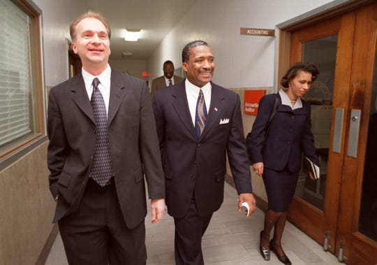 Willie Payne (center) is flanked by his deputy mayor Leon Jukowski and press secretary Georgette Johnson Tuesday as he heads to the ceremony at Pontiac City Hall where he will be sworn in as mayor January 1, 2002.
