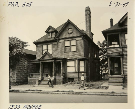 A street scene from the Black Bottom neighborhood in the summer of 1949. The house at 1535 Monroe St. was torn down in the 1950s to make way for I-75 construction.