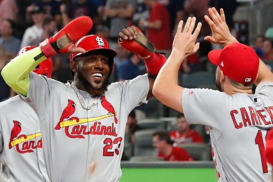 Cardinals left fielder Marcell Ozuna (23) celebrates his two-run double against the Braves in the ninth inning on Thursday.